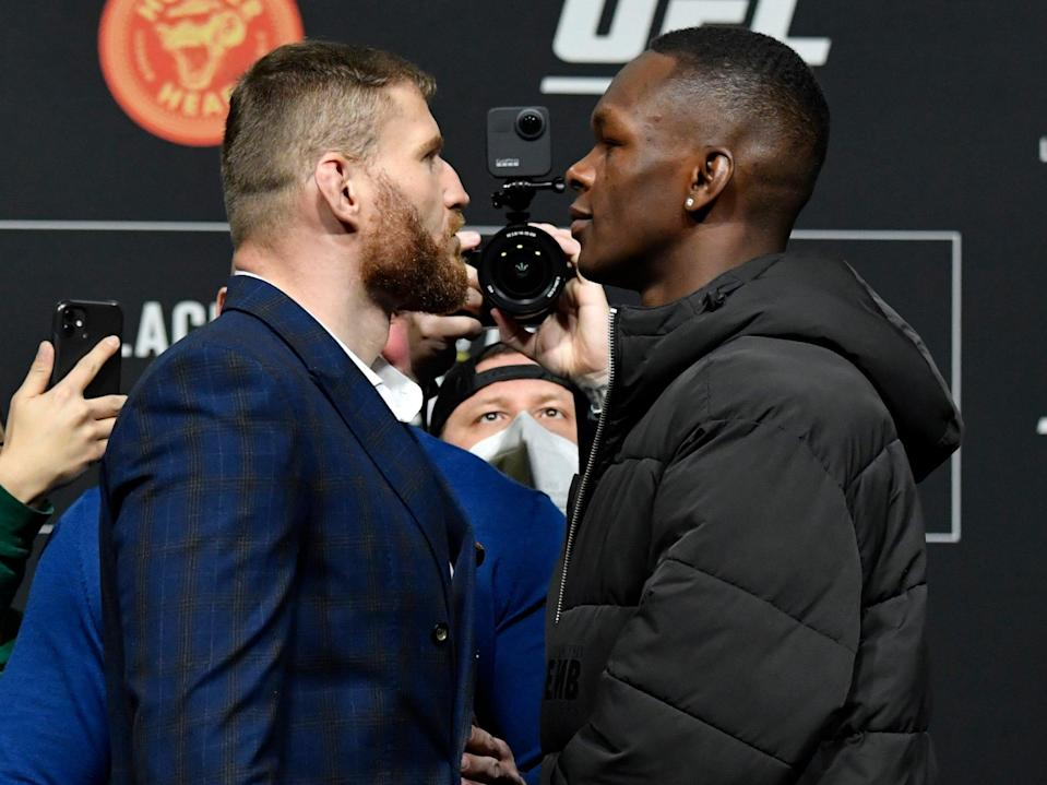 UFC light heavyweight champion Jan Blachowicz (left) and middleweight titleholder Israel Adesanya (Zuffa LLC via Getty Images)