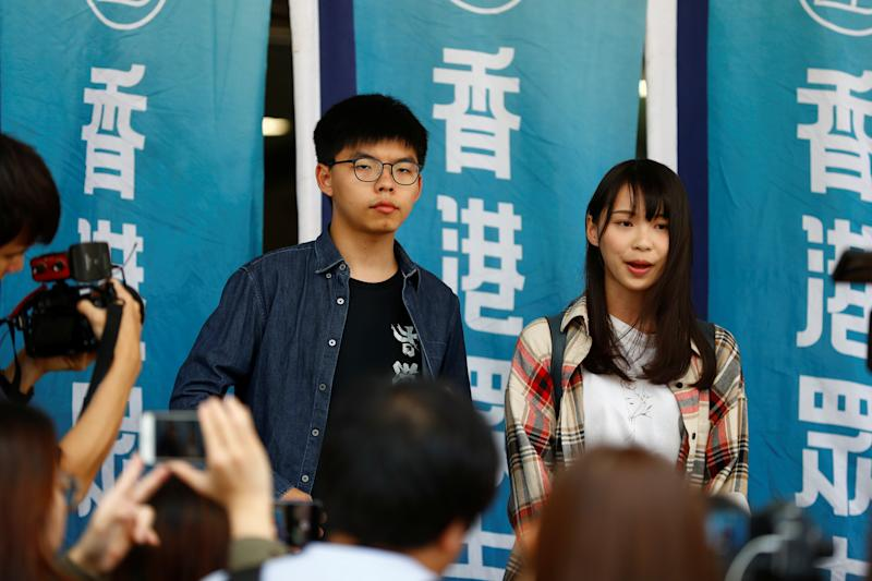 Hong Kong pro-democracy activists Joshua Wong and Agnes Chow speak to the media before entering Eastern Magistrates' Courts in Hong Kong, China November 8, 2019. REUTERS/Thomas Peter