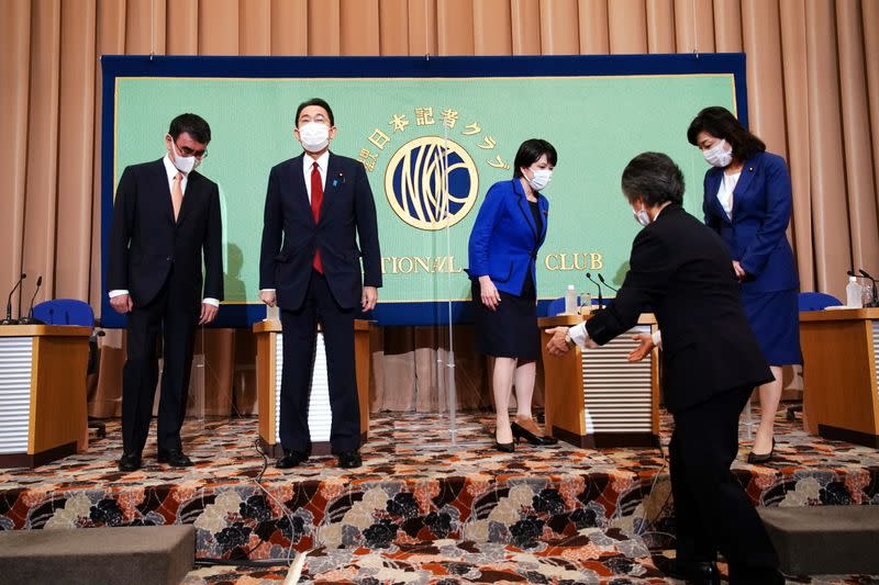 Candidates for the presidential election of the ruling Liberal Democratic Party prepare to pose for photographers prior to a debate session held by Japan National Press Club