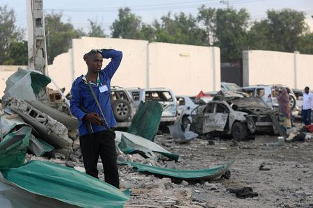 A security officer from Doorbin Hotel assesses the debris after a suicide car explosion in front of the hotel in Mogadishu, Somalia February 24, 2018. REUTERS/Feisal Omar