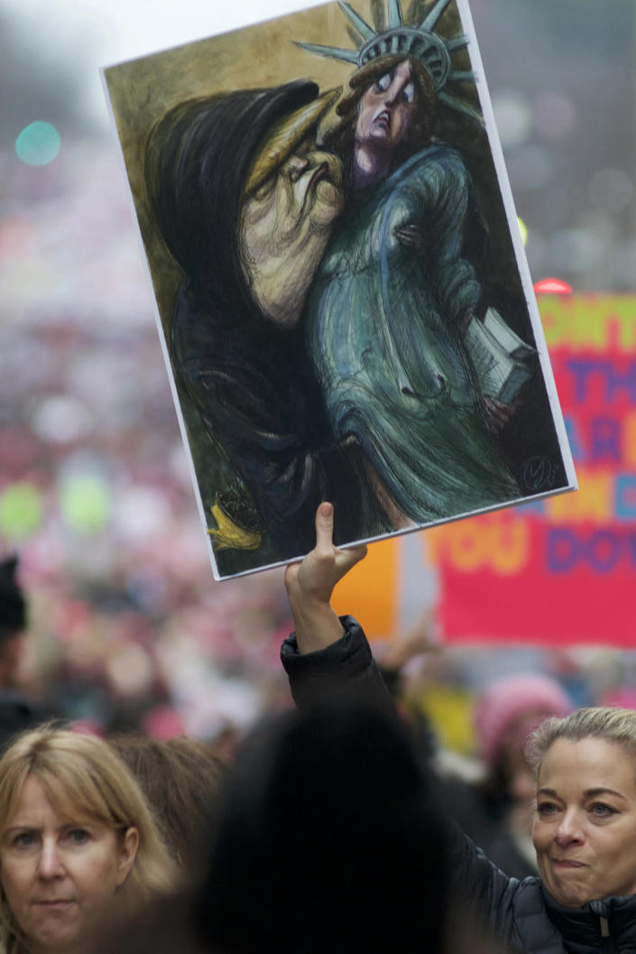 <p>Demonstrators hold up signs during the Womens March in Washington, Jan. 21, 2017. (Photo: Bastiaan Slabbers/NurPhoto via Getty Images) </p>