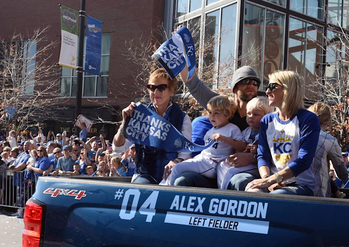 Alex Gordon (4) waves to the crowd at the Royals' World Series parade in 2015. (USA Today)