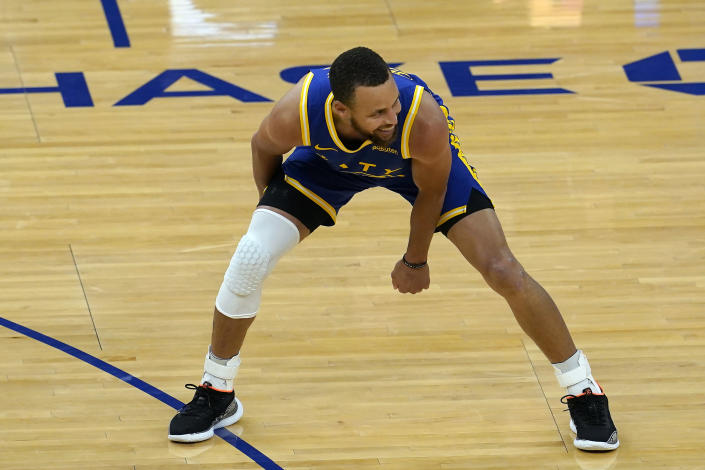 Golden State Warriors guard Stephen Curry smiles after shooting a 3-point basket during the second half of an NBA basketball game against the Utah Jazz in San Francisco, Monday, May 10, 2021. (AP Photo/Jeff Chiu)