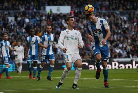 Soccer Football - La Liga Santander - Real Madrid vs Deportivo La Coruna - Santiago Bernabeu, Madrid, Spain - January 21, 2018. Deportivo de La Coruna's Fabian Schar in action with Real Madrid's Cristiano Ronaldo. REUTERS/Sergio Perez