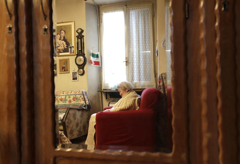 FILE - In this Tuesday, Nov. 29, 2016 file photo, Emma Morano sits in her home on the day of her 117th birthday in Verbania, Italy. An Italian doctor says Emma Morano, at 117 the world's oldest person, has died in her home in northern Italy. Dr. Carlo Bava told The Associated Press by telephone that Morano's caretaker called him to say the woman had passed away Saturday, April 15, 2017 afternoon while sitting in an armchair in her home in Verbania, a town on Lake Maggiore. (AP Photo/Antonio Calanni, File)