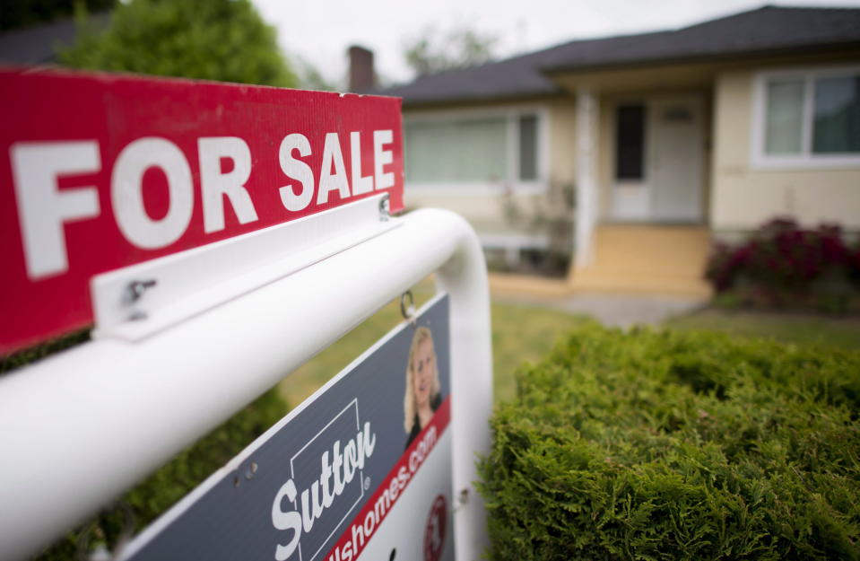A real estate sign is pictured in Vancouver on June 12, 2018. (Canadian Press)