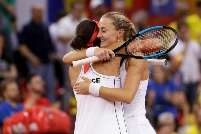 Final flourish: France's Kristina Mladenovic and Caroline Garcia celebrate victory