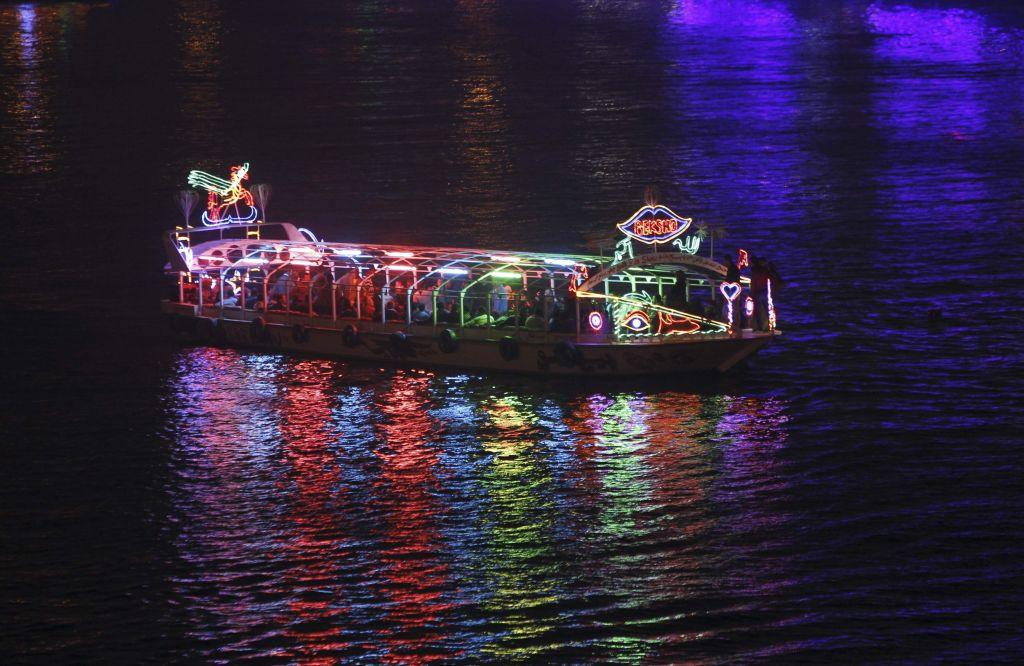 Egyptians dance on a pleasure boat travelling on the River Nile during New Year's Eve celebrations near Tahrir Square in Cairo, Egypt December 31, 2012.