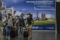 Tourists arrive at Faro airport in Portugal as the country eases restrictions