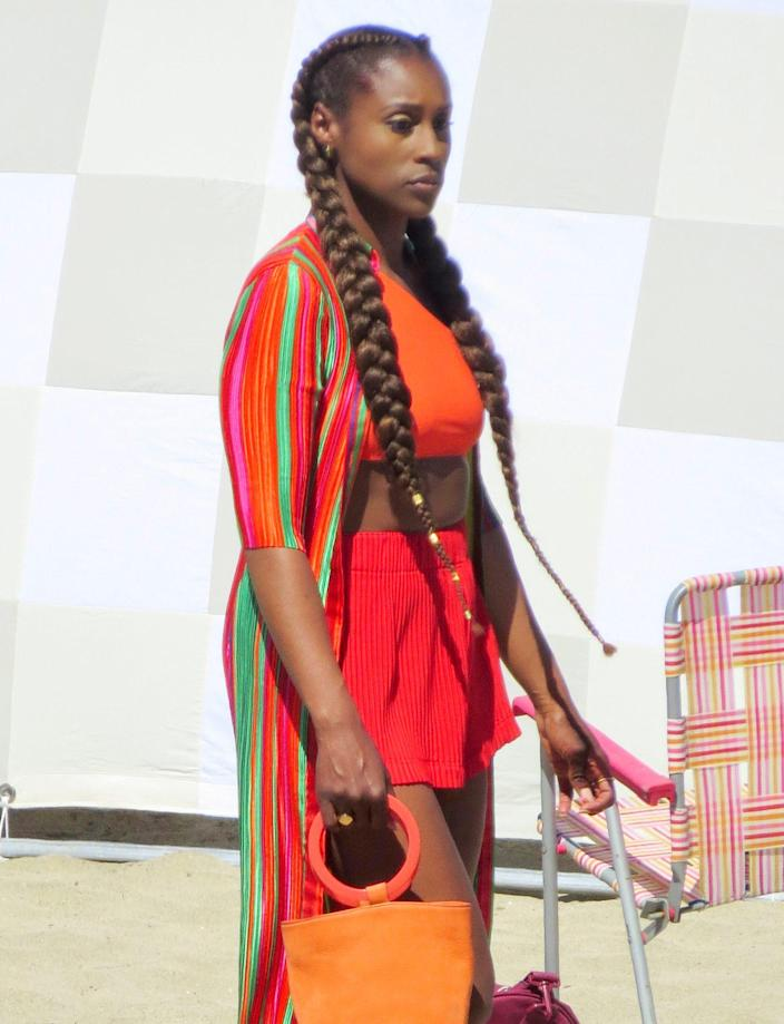 <p>Issa Rae brightens up the beach in red and orange while filming <i>Insecure</i> on Wednesday in L.A. </p>