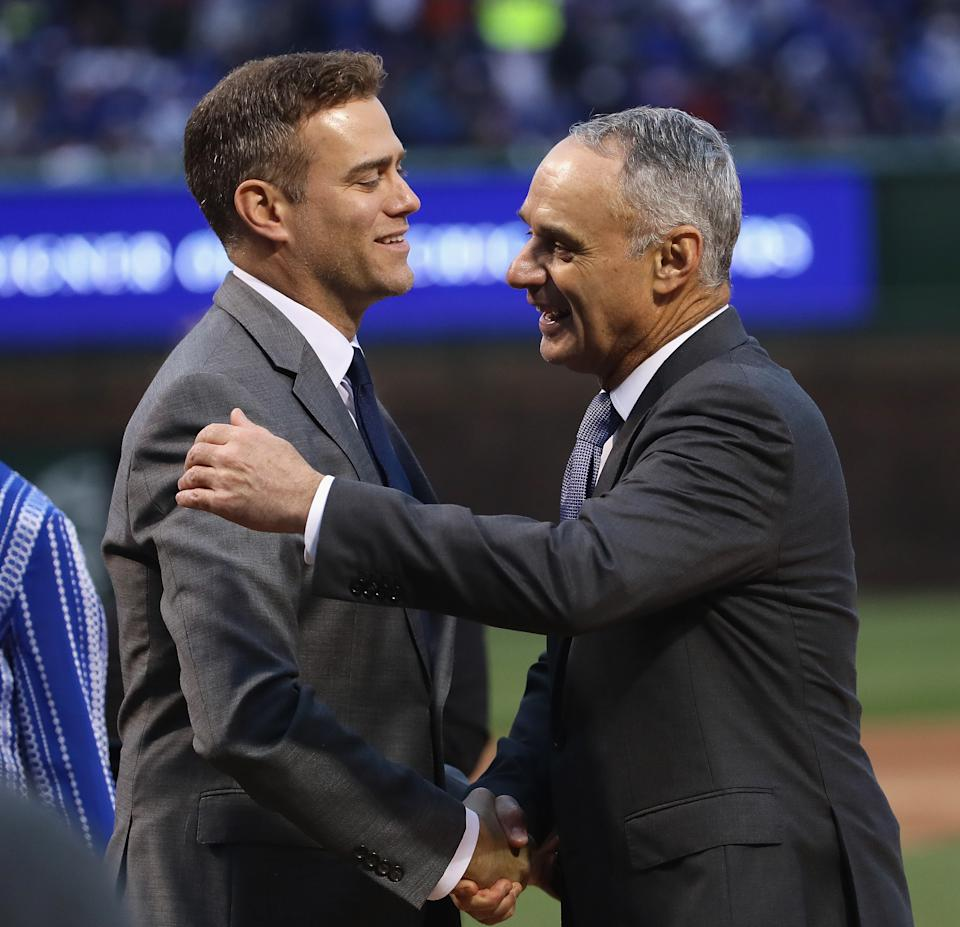 CHICAGO, IL - APRIL 12:  President Theo Epstein of the Chicago Cubs is congratulated by Rob Manfred, comissioner of Major League baseball, during a ring ceremony before a game against the Los Angeles Dodgers at Wrigley Field on April 12, 2017 in Chicago, Illinois.  (Photo by Jonathan Daniel/Getty Images)