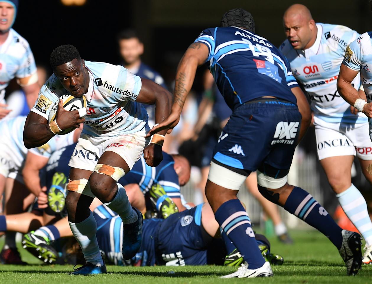 Racing 92's French flanker Yannick Nyanga (L) vies with Montpellier's Fijian flanker Akapusi qera (R) during the French Top 14 rugby union match between Montpellier and Racing 92 on May 20, 2017, at the Altrad stadium in Montpellier, southern France. (AFP Photo/PASCAL GUYOT)