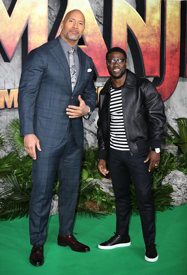 "Dwayne ""the Rock"" Johnson and Kevin Hart, pictured in 2017, have a fake feud going on, and it's spilled over to … trolling baby photos of their kids! (Photo: Mike Marsland/Mike Marsland/WireImage)"