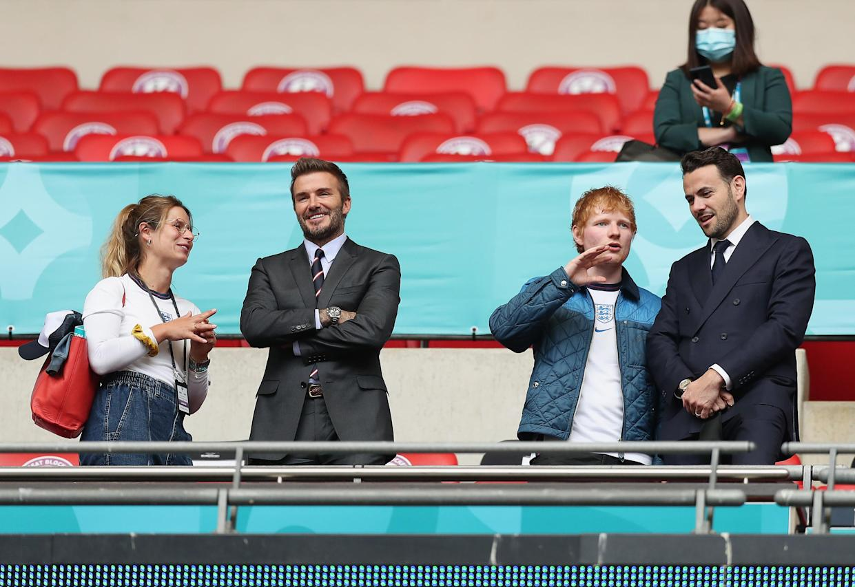 LONDON, ENGLAND - JUNE 29: (L-R) Cherry Seaborn, Wife of Ed Sheeran, David Beckham and Ed Sheeran are seen in the stands with a guest at half time during the UEFA Euro 2020 Championship Round of 16 match between England and Germany at Wembley Stadium on June 29, 2021 in London, England. (Photo by Alex Morton - UEFA/UEFA via Getty Images)