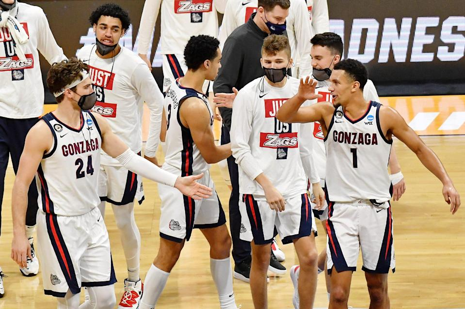 Gonzaga Bulldogs forward Corey Kispert (24) and guard Jalen Suggs (1) high five at the end of the first half in the second round of the 2021 NCAA Tournament at Hinkle Fieldhouse.