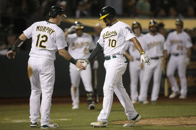 Oakland Athletics' Marcus Semien, right, is congratulated by Sean Murphy (12) after hitting a two-run home run against the Kansas City Royals in the second inning of a baseball game Monday, Sept. 16, 2019, in Oakland, Calif. (AP Photo/Ben Margot)
