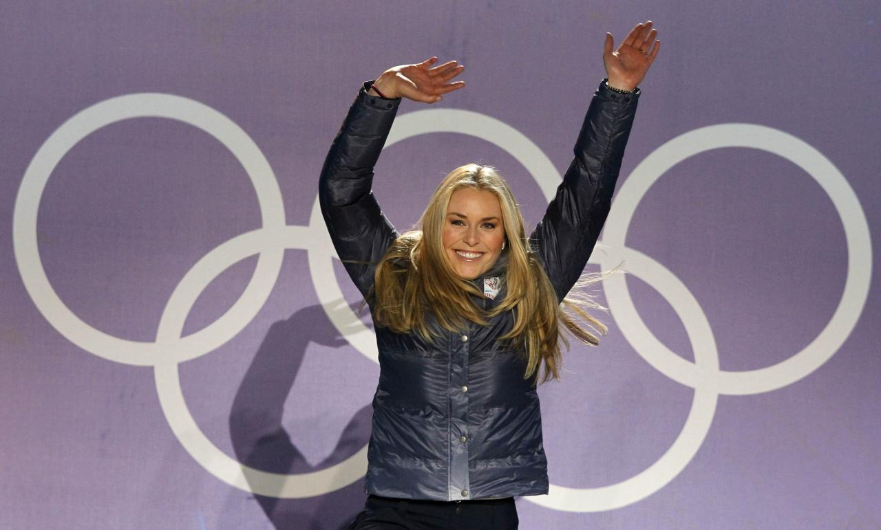 Lindsey Vonn of the United States, the gold medalist, reacts during the medal ceremony for the Women's downhill at the Vancouver 2010 Olympics in Whistler, British Columbia, Wednesday, Feb. 17, 2010.  (AP Photo/Alessandro Trovati)