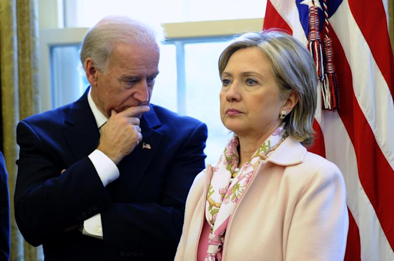 FILE - In this Dec. 7, 2009 file photo, then-Secretary of State Hillary Rodham Clinton stands with Vice President Joe Biden in the Oval Office of the White House in Washington. As Hillary Rodham Clinton's supporters urge her to run for president in 2016, the former first lady/senator/secretary of state makes her first public appearance since leaving government. Many Democrats see Clinton as the party's early front-runner, and some want her to signal her interest soon to lock down donors and supporters. Fueling the 2016 chatter: Vice President Joe Biden, another possible candidate, will speak at the same awards ceremony.  (AP Photo/Susan Walsh, File)