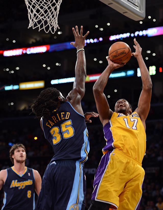 LOS ANGELES, CA - MAY 12: Andrew Bynum #17 of the Los Angeles Lakers shoots over Kenneth Faried #35 of the Denver Nuggets in the first quarter in Game Seven of the Western Conference Quarterfinals in the 2012 NBA Playoffs on May 12, 2012 at Staples Center in Los Angeles, California. NOTE TO USER: User expressly acknowledges and agrees that, by downloading and or using this photograph, User is consenting to the terms and conditions of the Getty Images License Agreement. (Photo by Harry How/Getty Images)