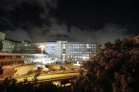 """A view at night of the Gemelli Polyclinic in Rome, where Pope Francis has been hospitalized for a scheduled surgery, Sunday, July 4, 2021. Pope Francis """"reacted well"""" to planned intestinal surgery Sunday evening at a Rome hospital, the Vatican announced. In a statement late Sunday, a Holy See spokesman, Matteo Bruni, said the 84-year-old Francis had general anesthesia during the surgery necessitated by a stenosis, or narrowing, of the sigmoid portion of the large intestine. (AP Photo/Riccardo De Luca)"""