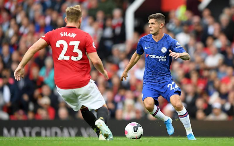 Luke Shaw rushes to challenge Christian Pulisic - GETTY IMAGES