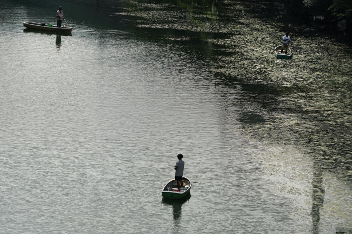 People fish in a moat ahead of the 2020 Summer Olympics on Thursday, July 15, 2021, in Tokyo. (AP Photo/Jae C. Hong)