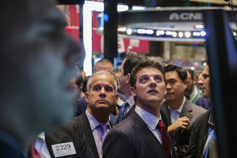 GrubHub CEO Matt Maloney looks up at a screen during the company's IPO, on the floor of the New York Stock Exchange in New York April 4, 2014. Shares of GrubHub Inc, the biggest U.S. online food-delivery service, rose as much as 57 percent in its market debut as investors scrambled for a piece of the fast-growing consumer internet company. REUTERS/Lucas Jackson (UNITED STATES - Tags: BUSINESS FOOD)