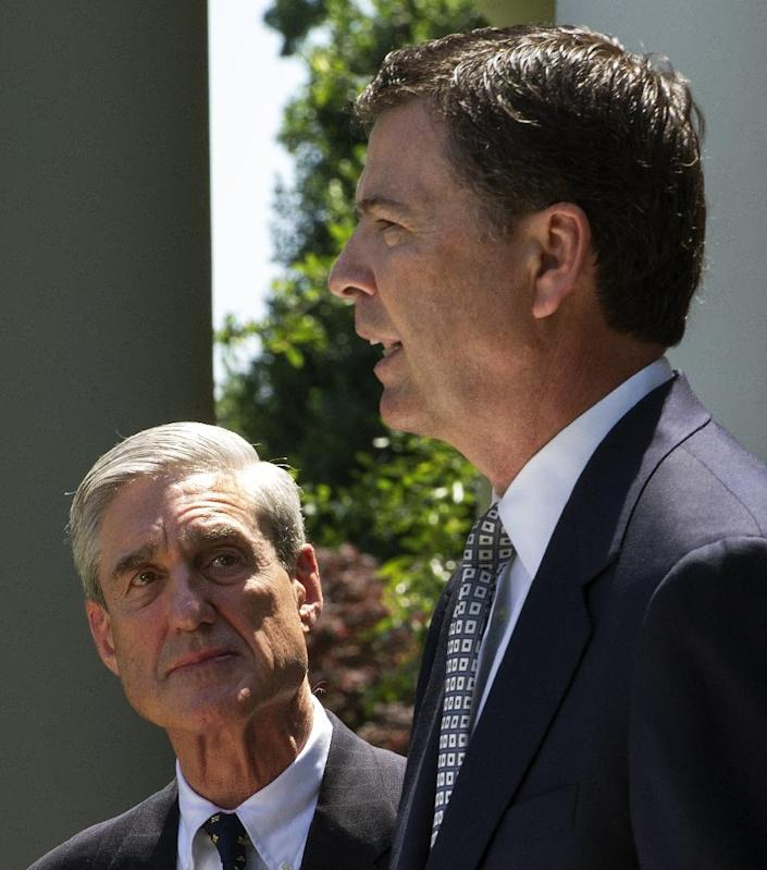 Former FBI director Robert Mueller (L) and his successor James Comey, shown here at the White House in 2013, have both been at the center of the widening Russia investigation (AFP Photo/PAUL J. RICHARDS)