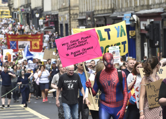 """<p>Scotland United Against Trump demonstrators march through Edinburgh, Scotland, during a """"Carnival of Resistance"""" to protest the visit of President Trump to the U.K., Saturday, July 14, 2018. (Photo: Lesley Martin/PA via AP) </p>"""