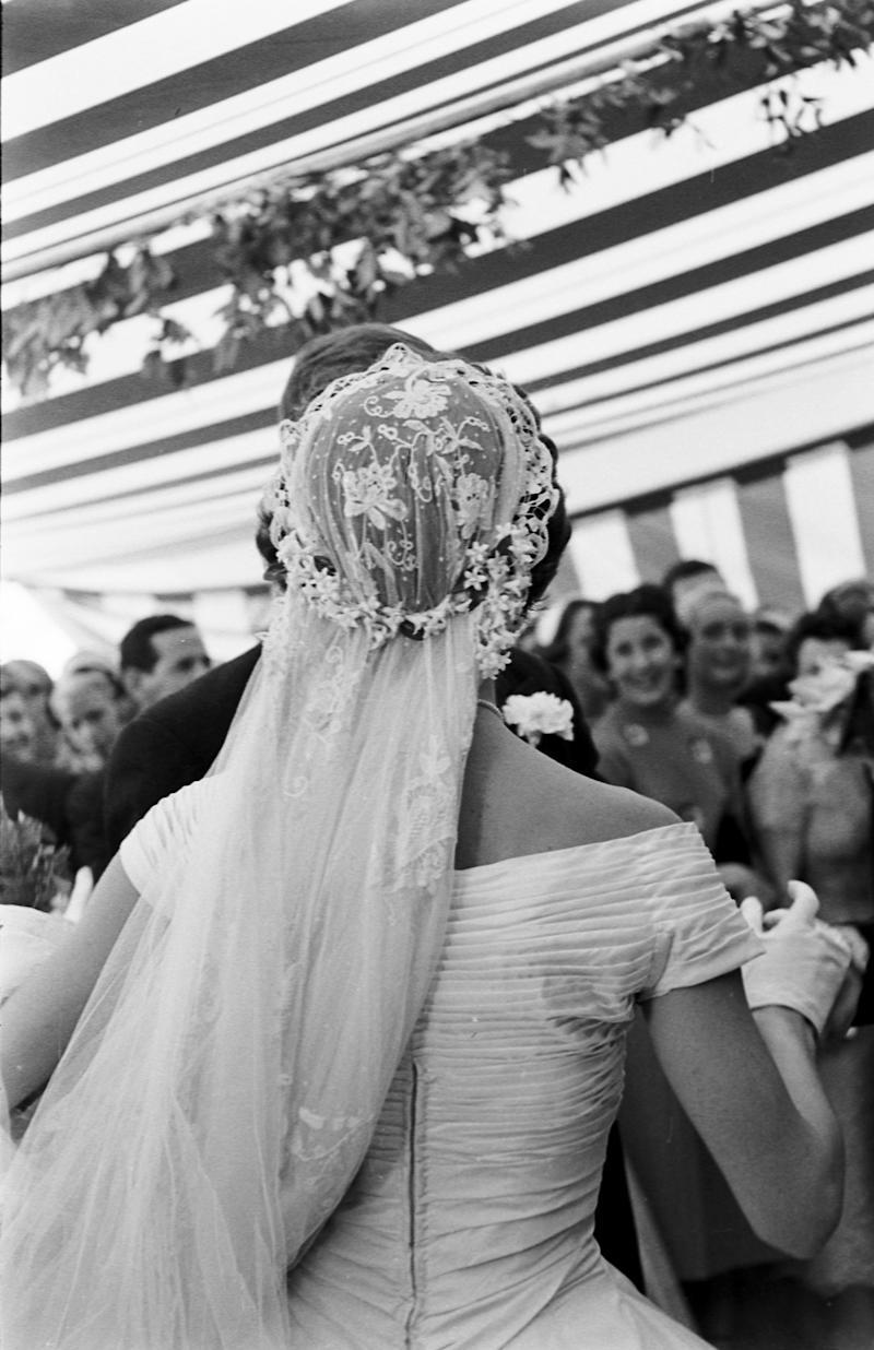 View from behind of Jacqueline Kennedy (1929 - 1994) (in a Battenburg wedding dress) as she dances with her husband, future US President John F Kennedy (1917 - 1963) at their wedding reception, Newport, Rhode Island, September 12, 1953. (Photo by Lisa Larsen/Time & Life Pictures/Getty Images)