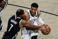 Brooklyn Nets' Kevin Durant (7) defends against Milwaukee Bucks' Giannis Antetokounmpo during the second half of Game 7 of a second-round NBA basketball playoff series Saturday, June 19, 2021, in New York. (AP Photo/Frank Franklin II)