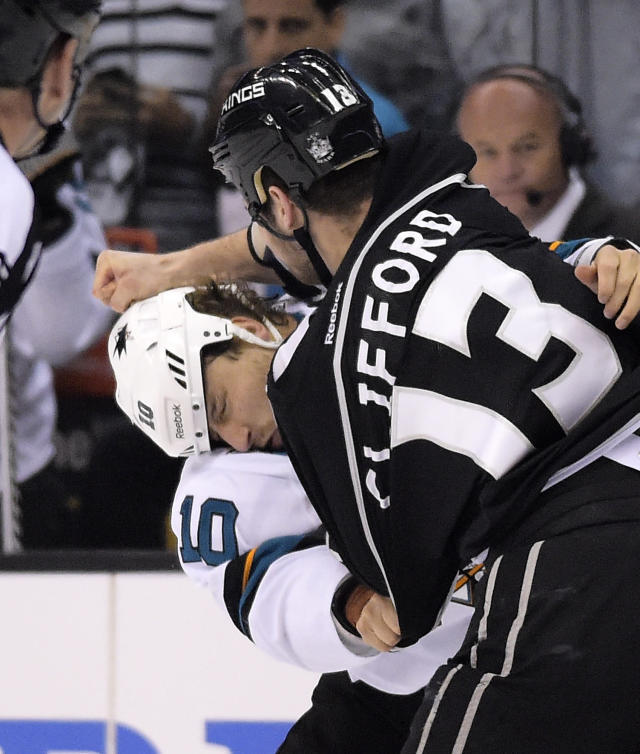 San Jose Sharks center Andrew Desjardins, left, fights with Los Angeles Kings left wing Kyle Clifford during the first period in Game 6 of an NHL hockey first-round playoff series, Monday, April 28, 2014, in Los Angeles. (AP Photo)