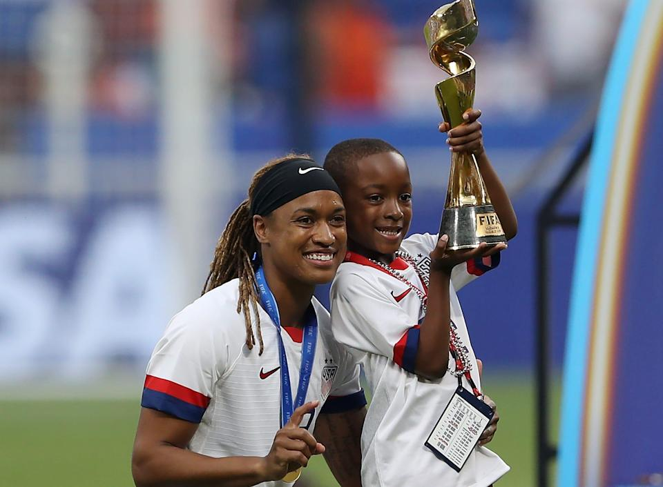 Jessica McDonald celebrates with her son following the USWNT's victory in the final of the 2019 FIFA Women's World Cup in France.