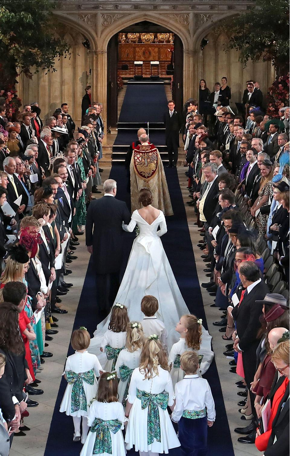 <p>Eugenie was followed by eight page boys and bridesmaids who included Prince George and Princess Charlotte. Photo: Getty </p>