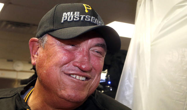 Pittsburgh Pirates manager Clint Hurdle smiles as he talks with reports and celebrates clinching a post season berth after a baseball game and 2-1 win over the Chicago Cubs Monday, Sept. 23, 2013, in Chicago. (AP Photo/Charles Rex Arbogast)
