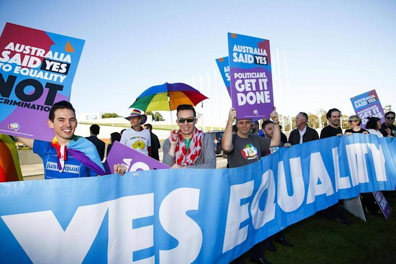 Equality campaigners gather in front of Parliament ahead of the same-sex marriage vote (AFP/Getty Images)