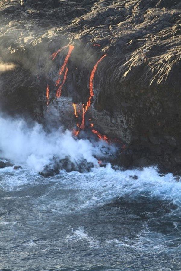 Lava overtopped a seaside cliff in Hawaii on Nov. 24, sending up steam plumes.