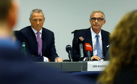 Chairman Rohner of Swiss bank Credit Suisse and Chairman of the Audit Committee Tiner listen to questions in Zurich