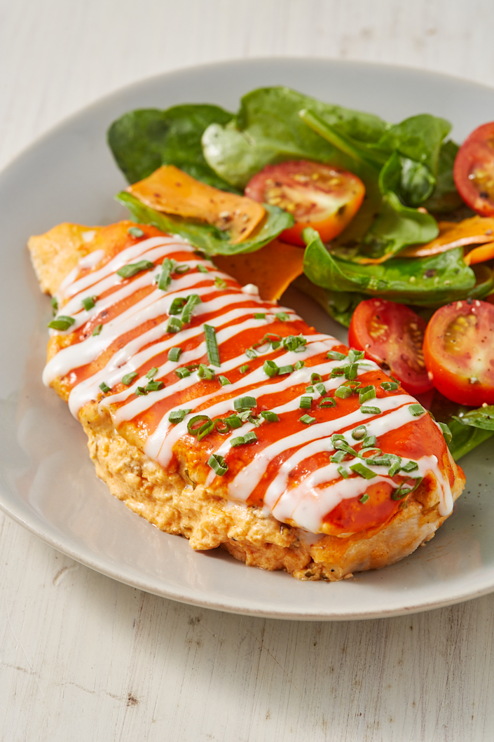 """<p>The perfect meal.</p><p>Get the recipe from <a href=""""https://www.delish.com/cooking/recipe-ideas/a28484022/buffalo-stuffed-chicken-recipe/"""" rel=""""nofollow noopener"""" target=""""_blank"""" data-ylk=""""slk:Delish"""" class=""""link rapid-noclick-resp"""">Delish</a>.</p>"""