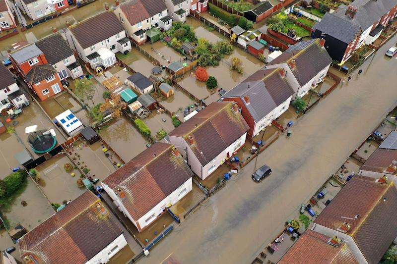Arial view of Doncaster houses and cars submerged in floodwater (Getty Images)