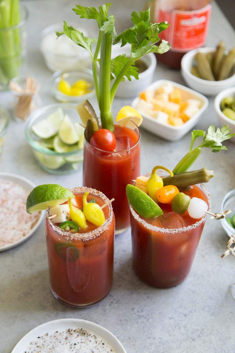 """<p>Or for something a little heartier, serve up bloody Marys three different ways. Your guests get to choose their """"poison:"""" vodka, tequila, or beer. </p><p><em>Get the recipe at <a href=""""https://www.thelittleepicurean.com/2018/12/stirrings-bloody-mary.html"""" rel=""""nofollow noopener"""" target=""""_blank"""" data-ylk=""""slk:The Little Epicurean"""" class=""""link rapid-noclick-resp"""">The Little Epicurean</a>. </em></p>"""