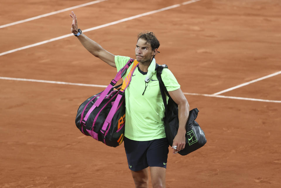 PARIS, FRANCE - JUNE 11: Rafael Nadal of Spain salutes the fans while leaving the court after his semi-final defeat againt Novak Djokovic of Serbia during day 13 of the French Open 2021, Roland-Garros 2021, Grand Slam tennis tournament at Roland Garros stadium on June 11, 2021 in Paris, France. (Photo by John Berry/Getty Images)