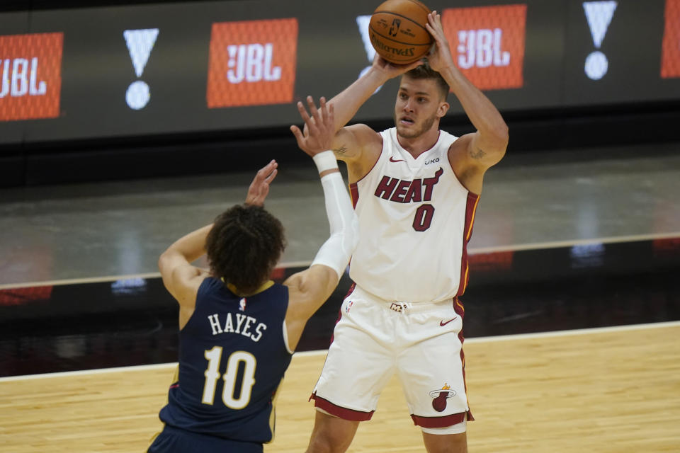 Miami Heat center Meyers Leonard (0) looks for an opening past New Orleans Pelicans center Jaxson Hayes (10) during the first half of a preseason NBA basketball game, Monday, Dec. 14, 2020, in Miami. (AP Photo/Wilfredo Lee)