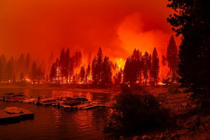 """Firefighters conduct a back-burn operation along CA-168 during the Creek fire as it approaches the Shaver Lake Marina on Sunday, Sept. 6, 2020. <span class=""""copyright"""">(Kent Nishimura / Los Angeles Times)</span>"""