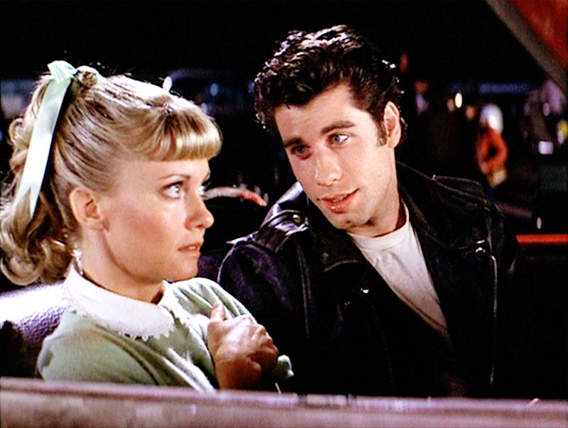 """LOS ANGELES - JUNE 16: The movie """"Grease"""", directed by Randal Kleiser. Seen here at the drive-in (from left) Olivia Newton-John as Sandy and John Travolta as Danny Zuko.Initial theatrical release of the film, June 16, 1978.Screen capture. Paramount Pictures. (Photo by CBS via Getty Images)"""