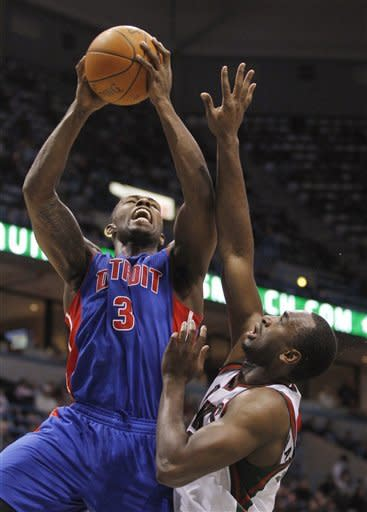 Detroit Pistons' Rodney Stuckey(3) puts up a shot against Milwaukee Bucks' Luc Richard Mbah a Moute, right, during the first half of an NBA basketball game Monday, Jan. 30, 2012, in Milwaukee. (AP Photo/Jeffrey Phelps)