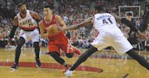Houston Rockets' Jeremy Lin (7) drives against Portland Trail Blazers' Thomas Robinson (41) and Mo Williams (25) during the first half of game six of an NBA basketball first-round playoff series game in Portland, Ore., Friday May 2, 2014. (AP Photo/Greg Wahl-Stephens)