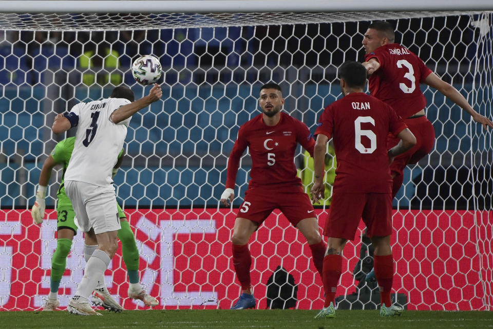 Italy's Giorgio Chiellini heads the ball during the Euro 2020, soccer championship group A match between Italy and Turkey, at the Rome Olympic stadium, Friday, June 11, 2021. (Alfredo Falcone/LaPresse via AP)
