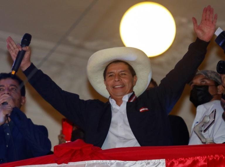 Leftist school teacher Pedro Castillo celebrates from the balcony of the Peru Libre party headquarters in Lima, following the official proclamation of him as Peru's president-elect on July 19, 2021