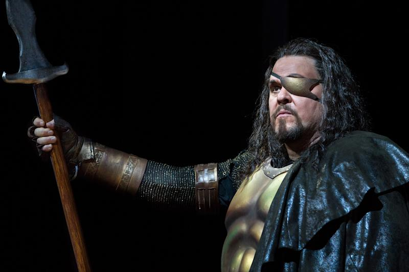"In this April 3, 2013 photo provided by the Metropolitan Opera, Mark Delavan performs in the role of Wotan in Wagner's ""Das Rheingold,"" during the final dress rehearsal at the Metropolitan Opera in New York. (AP Photo/Metropolitan Opera, Marty Sohl)"